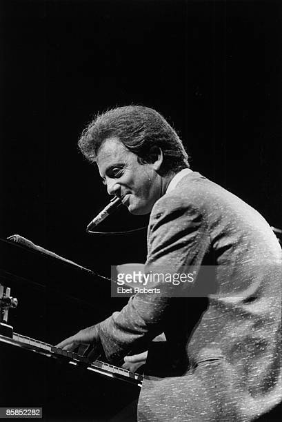 GARDEN Photo of Billy JOEL Billy Joel performing on stage piano