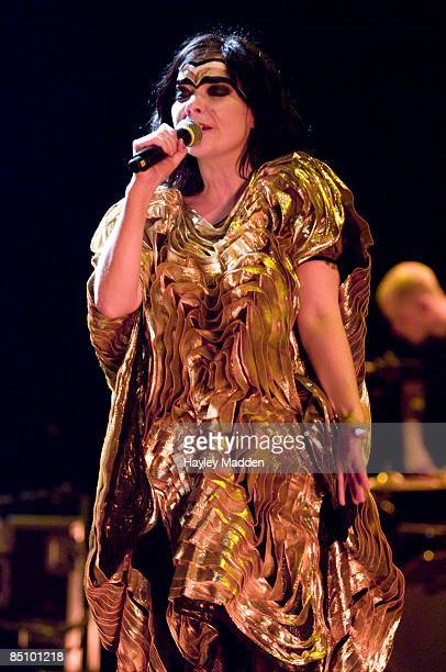 APOLLO Photo of BJORK Bjork performing on stage costume