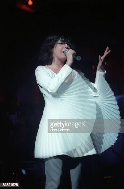 BALLROOM Photo of BJORK Bjork performing on stage wearing wing sleaved top