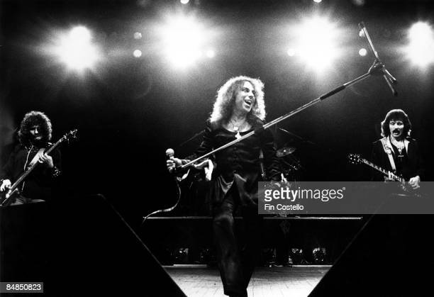 Photo of BLACK SABBATH and Ronnie DIO LR Geezer Butler Ronnie Dio Tony Iommi performing live onstage at Gaumont