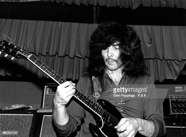 CLUB Photo of BLACK SABBATH and Tony IOMMI Tony Iommi performing on stage as 'Earth'