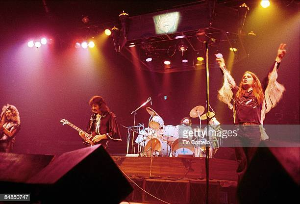 Geezer Butler Tony Iommi Bill Ward Ozzy Osbourne performing live onstage