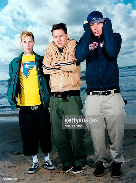Photo of BLINK 182 and Travis BARKER and Tom DELONGE and Mark HOPPUS Posed group full length portrait LR Travis Barker Tom DeLonge and Mark Hoppus...