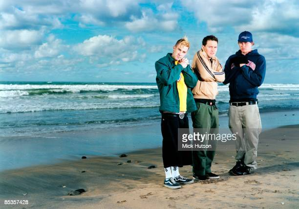 Photo of BLINK 182 and Travis BARKER and Tom DELONGE and Mark HOPPUS Posed group full length portrait LR Travis Barker Mark Hoppus and Tom DeLonge...