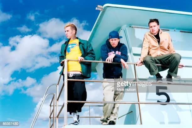Photo of BLINK 182 and Travis BARKER and Tom DELONGE and Mark HOPPUS; Posed group full length portrait L-R Travis Barker, Tom DeLonge and Mark...
