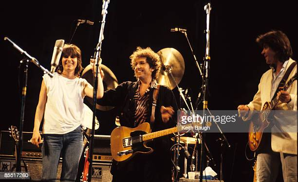 STADIUM Photo of Bob DYLAN and Chrissie HYNDE and Mick TAYLOR Chrissie Hynde Bob Dylan and Mick Taylor performing on stage