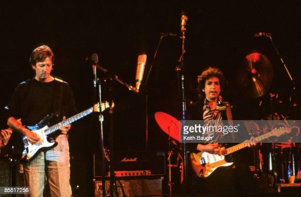 STADIUM Photo of Bob DYLAN and Eric CLAPTON Eric Clapton and Bob Dylan performing on stage