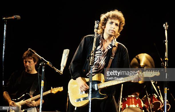 STADIUM Photo of Bob DYLAN and Eric CLAPTON Eric Clapton and Bob Dylan performing on stage