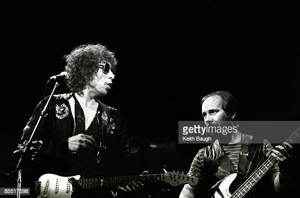 COURT Photo of Bob DYLAN and Tim DRUMMOND Bob Dylan and Tim Drummond performing on stage sunglasses