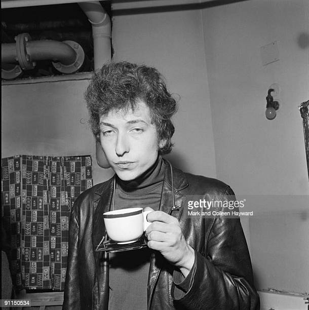 Photo of Bob DYLAN, backstage at his famous Free Trade Hall Concert, drinking cup of tea
