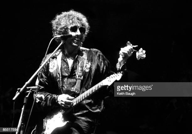 COURT Photo of Bob DYLAN Bob Dylan performing on stage sunglasses flower