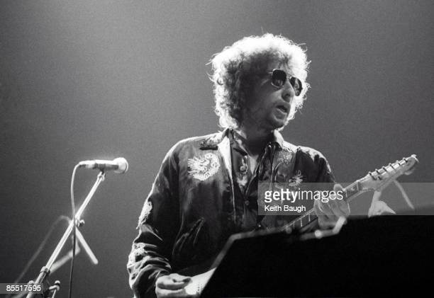 COURT Photo of Bob DYLAN Bob Dylan performing on stage sunglasses