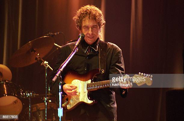 Photo of Bob DYLAN Bob Dylan performing on stage sunglasses