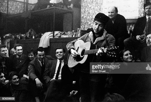 Photo of Bob DYLAN performing at the Singers Club Christmas party on his first visit to Britain