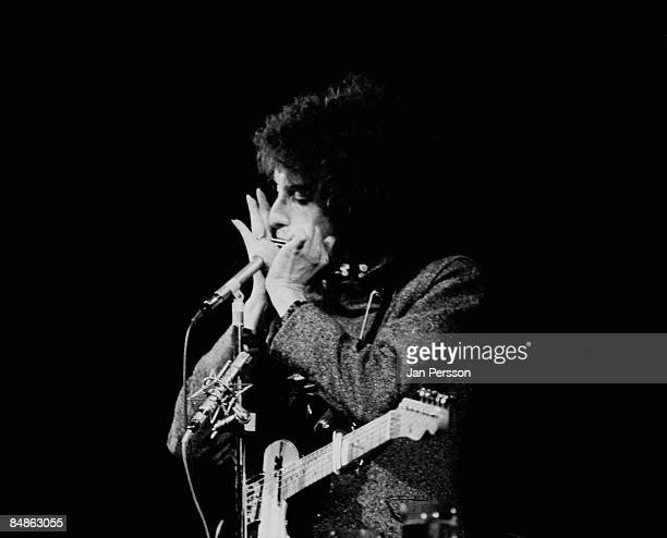 Photo of Bob DYLAN performing live onstage playing harmonica