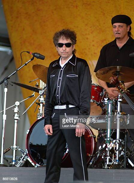 FESTIVAL Photo of Bob DYLAN posed live onstage wearing sunglasses looking to camera