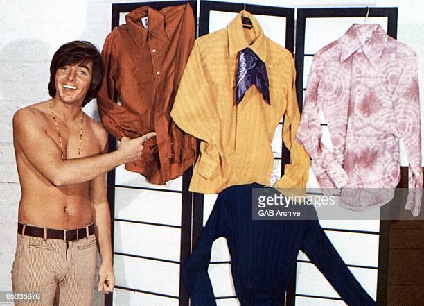 Photo of Bobby SHERMAN Posed portrait of Bobby Sherman barechested pointing at shirts