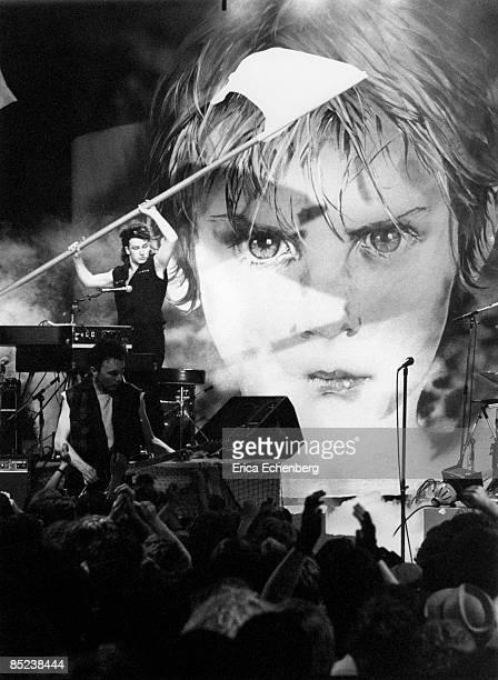 Photo of BONO and U2 Bono performing live on the Tube TV Show waving flag