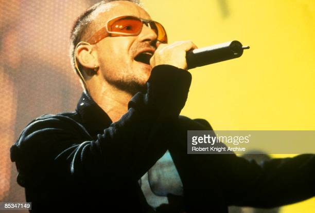 Photo of BONO and U2 Bono performing live onstage on first date of PopMart tour