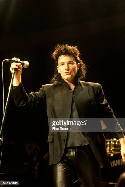 Photo of BONO and U2 Bono performing live onstage on The Unforgettable Fire tour