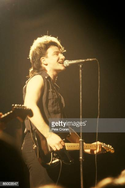 PALAIS Photo of BONO and U2 Bono performing live onstage on War tour