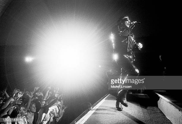 Photo of BONO and U2, Bono performing live onstage on ZOO TV tour at Ahoy in Rotterdam, Netherlands on June 15th 1992.