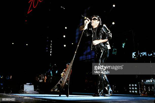 STADIUM Photo of BONO and U2 Bono performing live onstage on Zoo TV Zooropa tour wearing leather suit and sunglasses