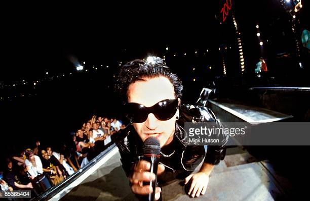STADIUM Photo of BONO and U2 Bono performing live onstage on Zoo TV Zooropa tour wearing sunglasses looking into camera showing front rows of audience