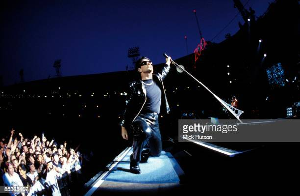 STADIUM Photo of BONO and U2 Bono performing live onstage on Zoo TV Zooropa tour showing first rows of audience and stadium roof