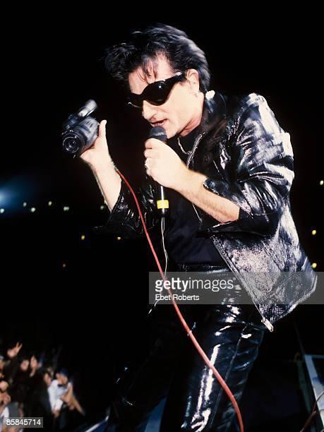 STADIUM Photo of BONO and U2 Bono performing live onstage on Zoo TV Zooropa tour
