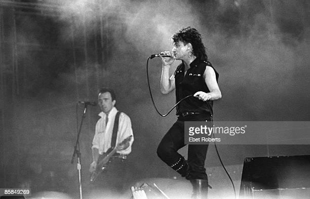 Photo of BONO and U2 The Edge Bono performing live onstage at the US Festival at San Bernadino