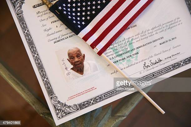 A photo of Braulia Fabian looks from her citizenship certificate after she took the oath of allegiance to the United States at a homebound...