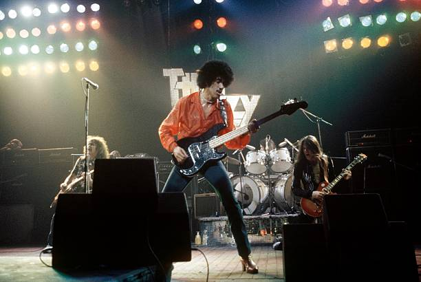 Photo of Brian DOWNEY and Brian ROBERTSON and THIN LIZZY and Phil LYNOTT and Scott GORHAM