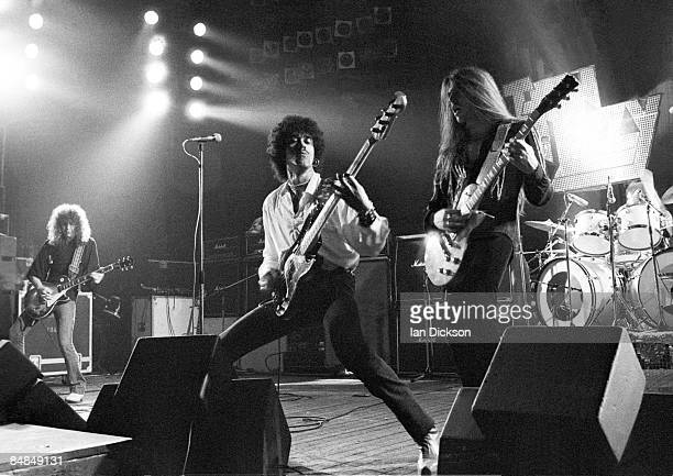 Photo of Brian DOWNEY and THIN LIZZY and Brian ROBERTSON and Phil LYNOTT and Scott GORHAM LR Brian Robertson Phil Lynott Scott Gorham Brian Downey