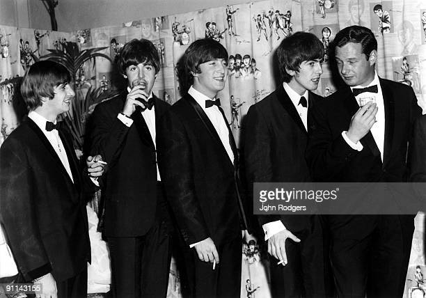 Photo of Brian EPSTEIN and BEATLES Ringo Starr Paul McCartney John Lennon George Harrison Brian Epstein posed group shot at the Premier of A Hard...