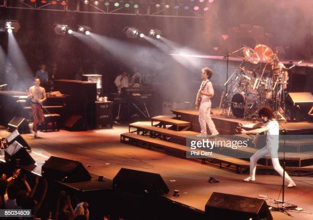 ARENA Photo of Brian MAY and Freddie MERCURY and John DEACON and QUEEN LR Freddie Mercury John Deacon Roger Taylor Brian May performing live on stage