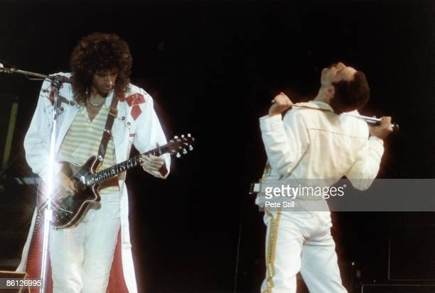 Photo of Brian MAY and Freddie MERCURY and QUEEN, L-R: Brian May and Freddie Mercury performing live on stage