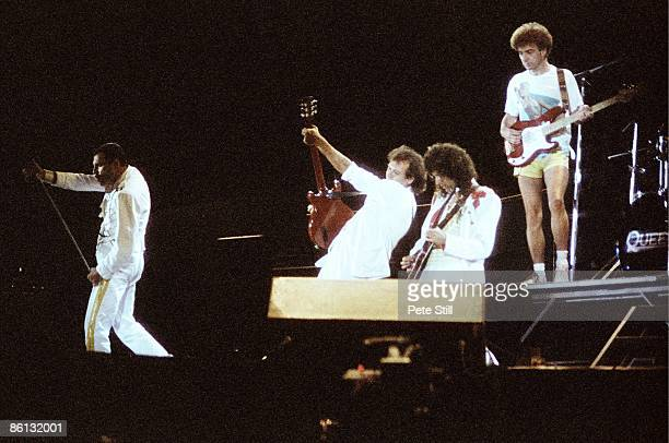 Photo of Brian MAY and QUEEN and Freddie MERCURY and John DEACON, L-R: Freddie Mercury, Spike Edney, Brian May and John Deacon performing live on...
