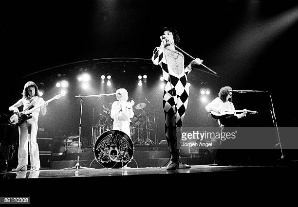 Photo of Brian MAY and QUEEN and Freddie MERCURY and Roger TAYLOR LR John Deacon Roger Taylor Freddie Mercury and Brian May performing live on stage...