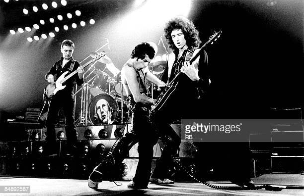 Photo of Brian MAY and QUEEN and John DEACON and Freddie MERCURY LR John Deacon Freddie Mercury and Brian May performing live on stage