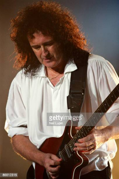 ARENA Photo of Brian MAY and QUEEN Brian May performing on stage