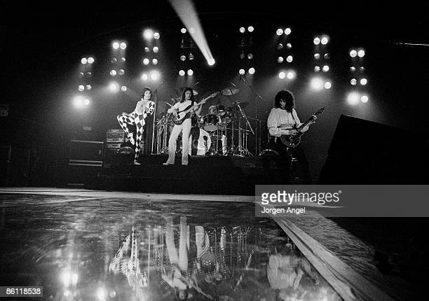 Photo of Brian MAY and Roger TAYLOR and Freddie MERCURY and QUEEN L R Freddie Mercury John Deacon Roger Taylor and Brian May performing live on stage...