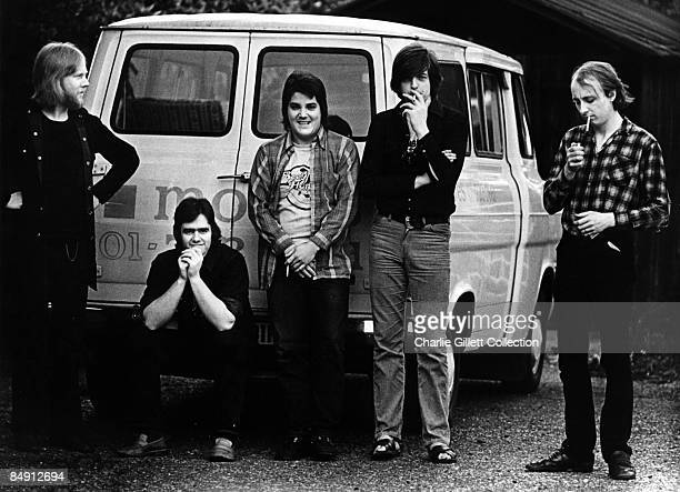 Photo of BRINSLEY SCHWARZ; posed with transit van, Nick Lowe smoking second right