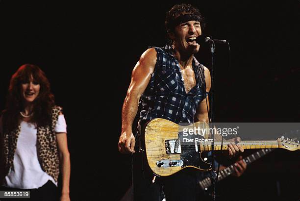 Photo of Bruce SPRINGSTEEN and Patti SCIALFA Patti Scialfa and Bruce Springsteen performing on stage