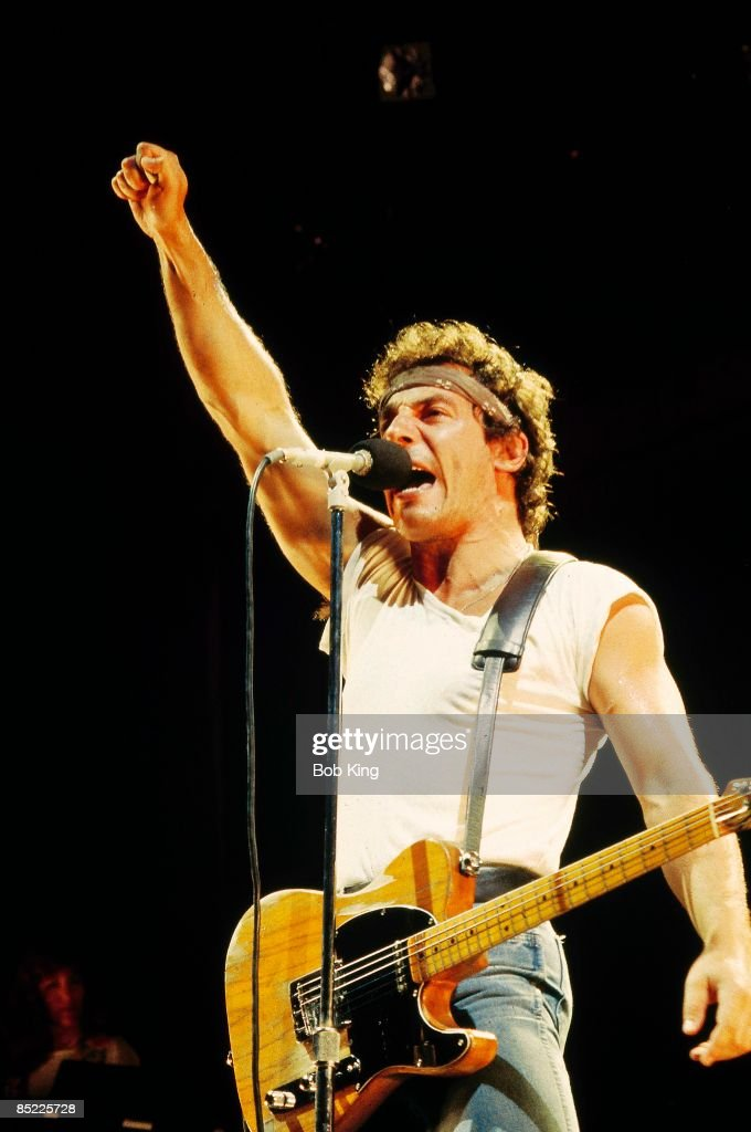 Photo of Bruce SPRINGSTEEN; performing live onstage, with fist in the air, on Born In The USA tour