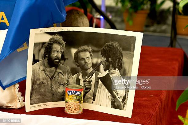 A photo of Bud Spencer and Terence Hill and a tin of beans brought by fans in front the coffin of Italian actor Bud Spencer lying in repose at Rome's...