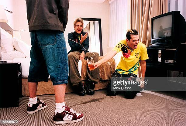 Photo of BUSTED and Charlie SIMPSON and James BOURNE and Matt WILLIS Group portrait LR James Bourne Charlie Simpson and Matt Willis trashing hotel...