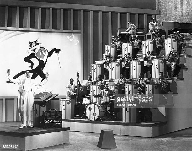 Photo of Cab CALLOWAY Cab Calloway performing on stage with band and cartoon cat on screen