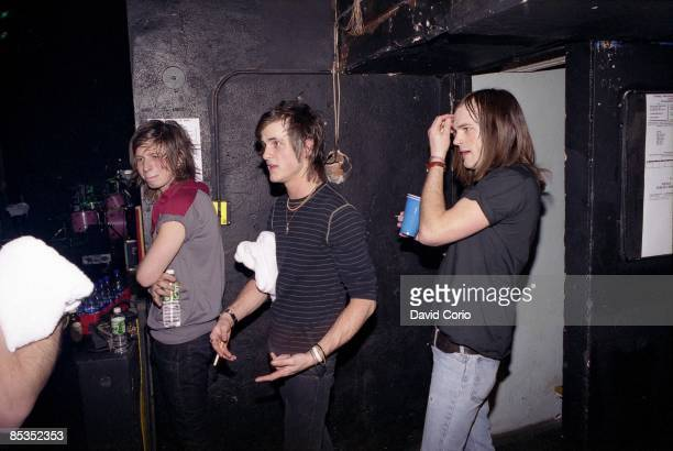 Photo of Caleb FOLLOWILL and Jared FOLLOWILL and Matthew FOLLOWILL and KINGS OF LEON L R Matthew Jared and Caleb Followill in between encores at the...