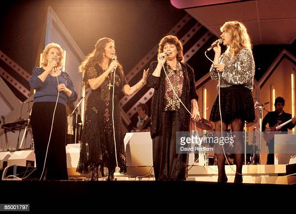 Photo of Carlene CARTER and June CARTER and CARTER FAMILY, L-R Helen Carter, June Carter Cash, Anita Carter and Carlene Carter performing on stage at...